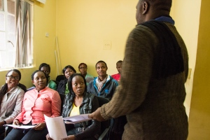 Participants being given information by a staff member at the Busara Center. Photo by Kelly Ranck